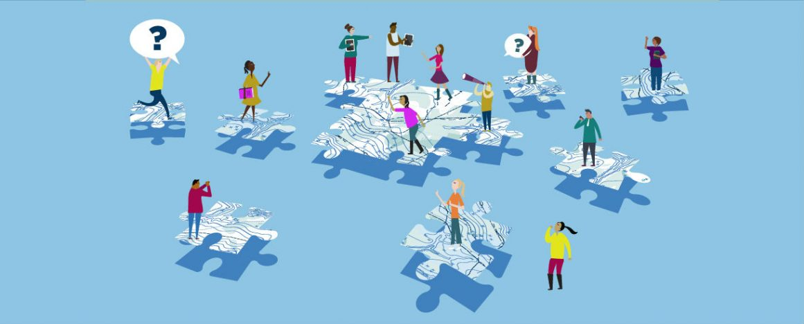 young people on puzzle pieces of map