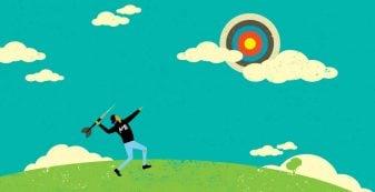 Man in AIME hoodie throwing a dart at target in the sky