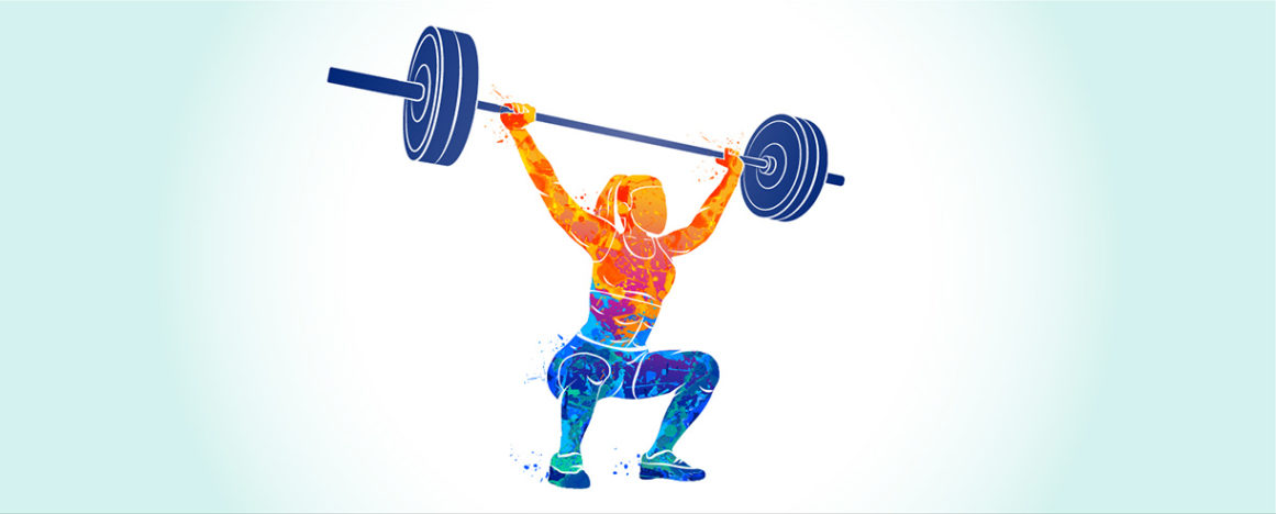 woman weightlifter holding weight bar above head in crouch