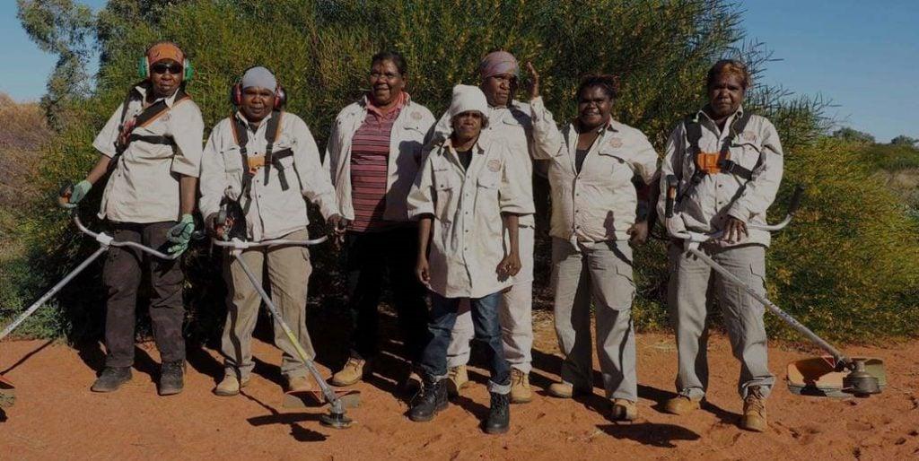 Parnngurr women's ranger team carrying out maintenance work