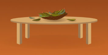 Oval table with a coolamon in centre filled with gum leaves