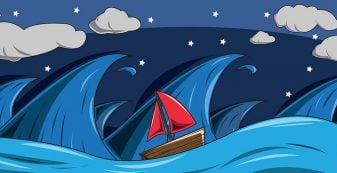 sail boat amidst big stormy sea
